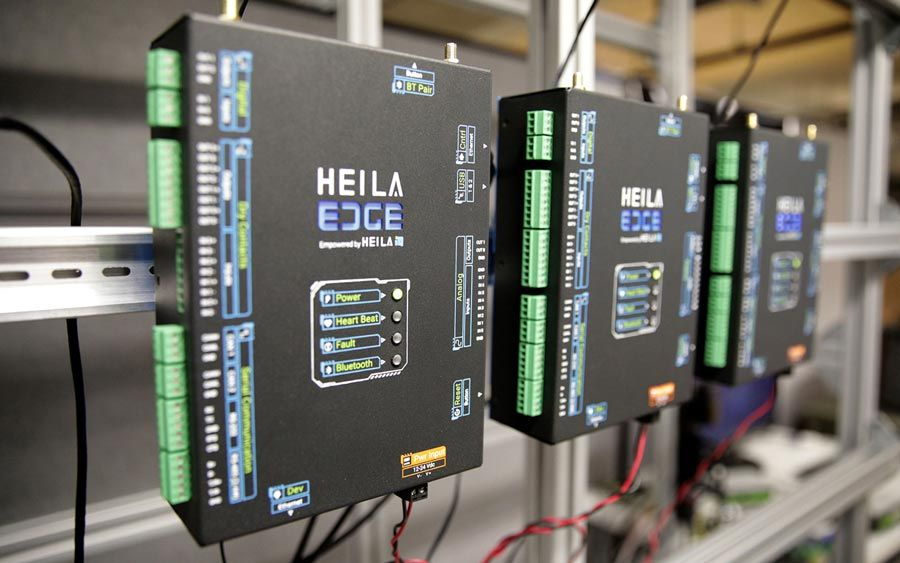 Three Heila control platform Edge devices mounted on racks.